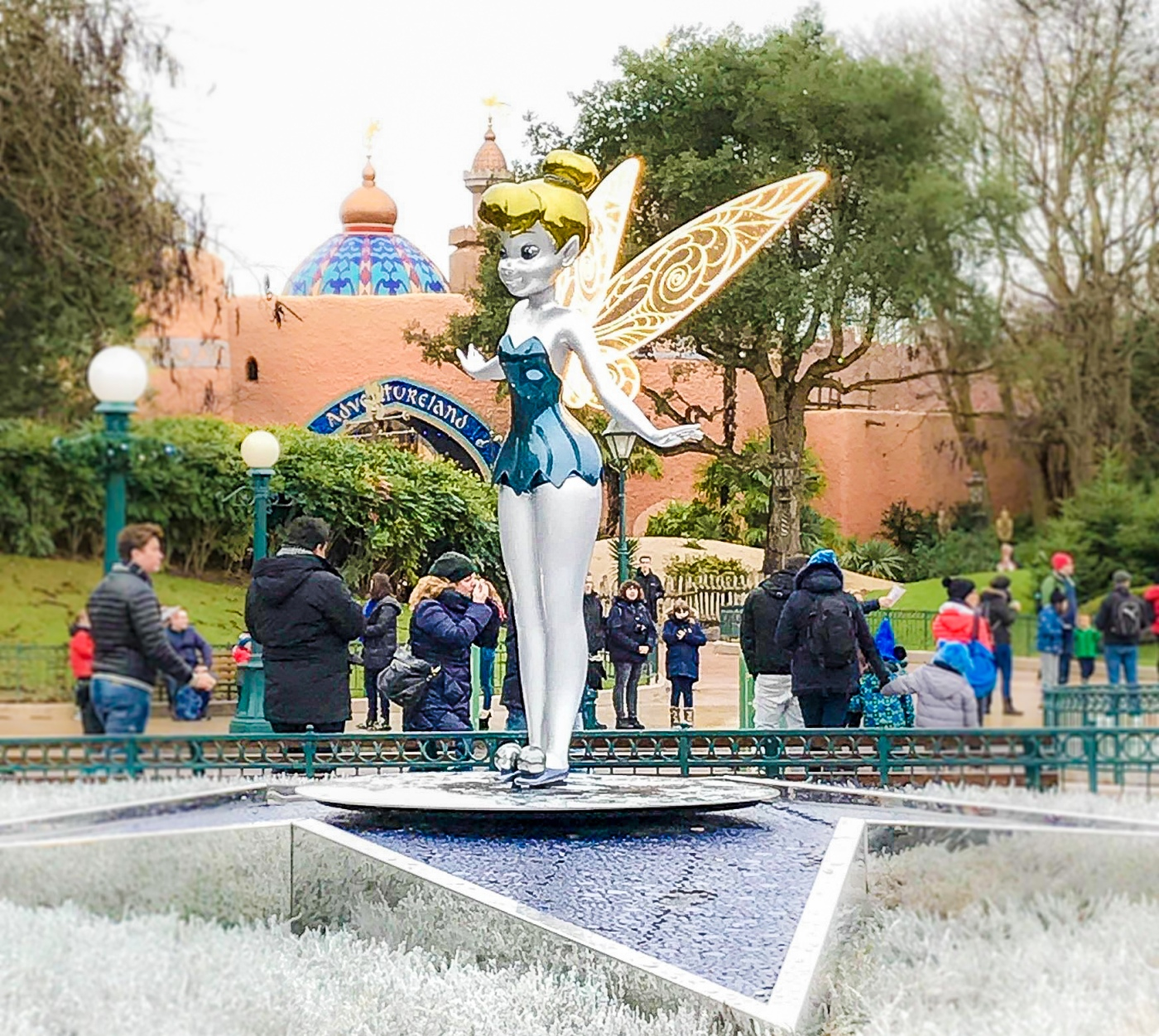 Silver, gold and blue Tinkerbell statue in the Magic Kingdom just before you reach Sleeping Beauty's castle