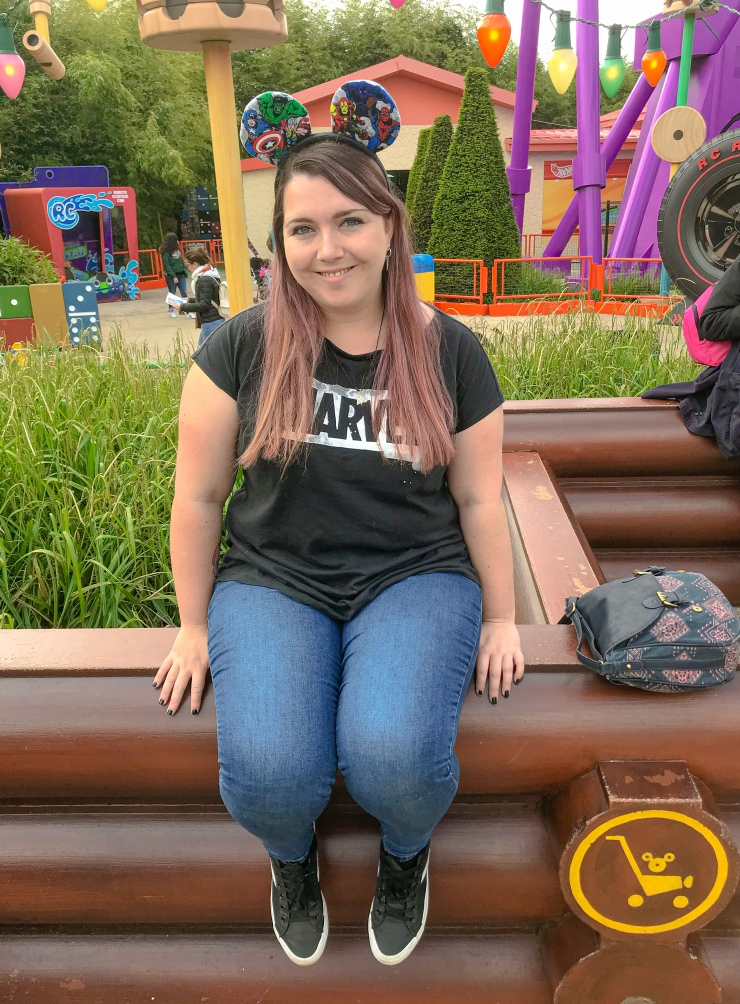 Sitting on the wall in Toy Story Playland at Disneyland Paris with my Marvel ears