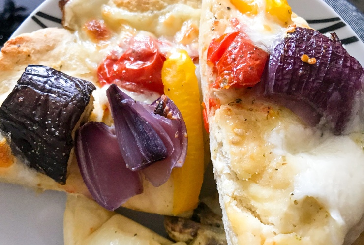 Sliced roasted vegetable, mozzarella and garlic flatbread