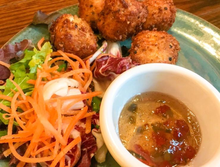Crispy halloumi bites with a citrus salad and jalapeño jelly